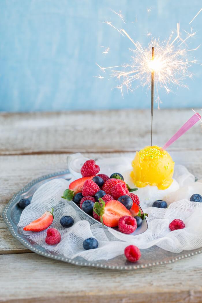 mango ice cream with berries